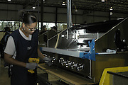 Tereace Self an employee at the Viking range plant works on production line for the outdoor gas ranges Monday Nov.1 2004..(Photo Suzi Altman)
