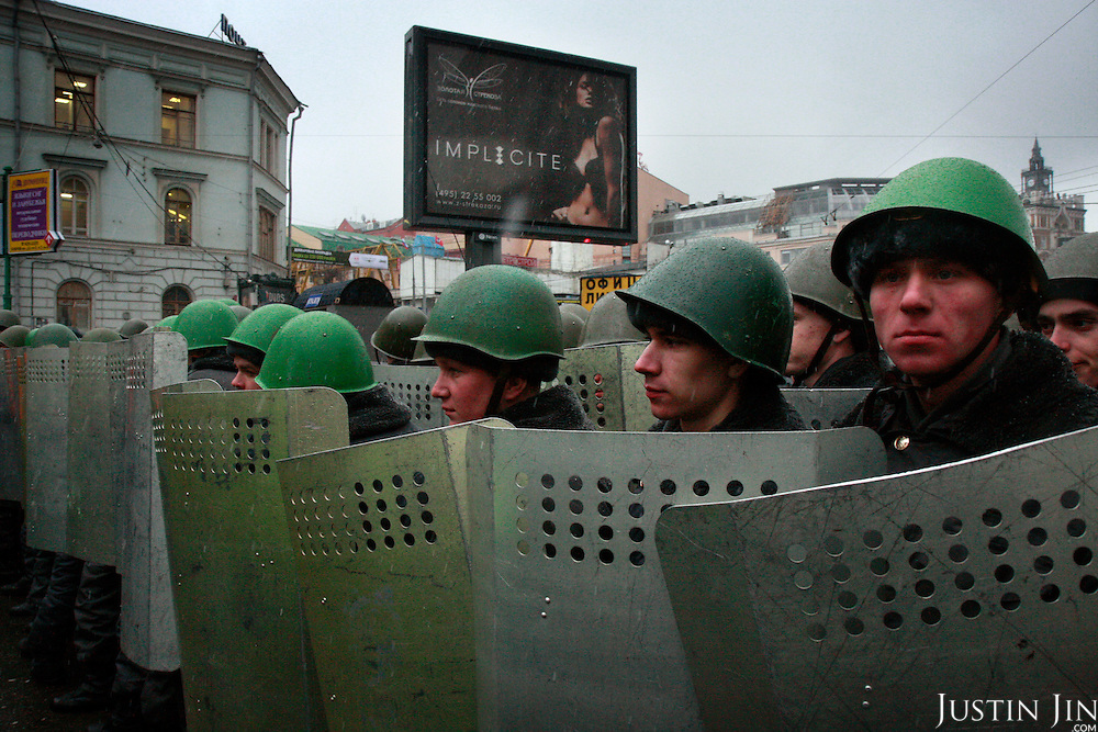 Russian police prepare to arrest protesters, who demonstrated in Moscow against what they said were rigged presidential elections..Russia went to the poll the day before to vote for Vladimir Putin's chosen successor, Dmitry Medvedev. .The protesters are part of a loose coalition of opposition members led by the former world chess champion Garry Kasparov and writer Eduard Limonov.