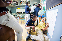Epiphany School students collaborate during class.