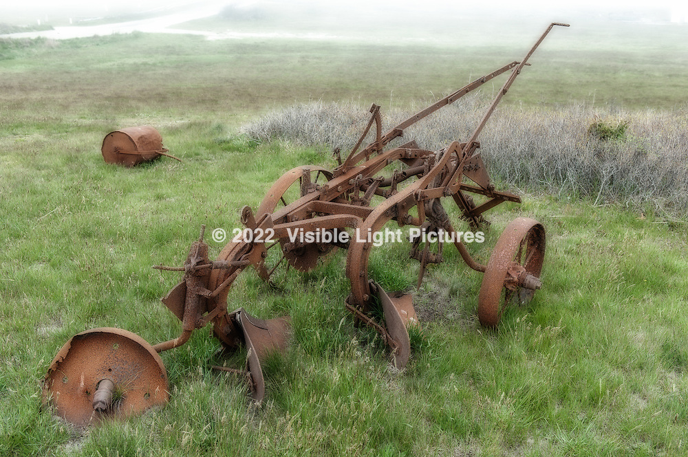 Rusted farming implement on Nantucket island, Massachusetts, USA