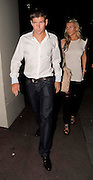 27.JULY.2009 - LONDON<br /> <br /> LIVERPOOL AND ENGLAND FOOTBALLER STEVEN GERRARD LEAVING NOBU RESTAURANT, BERKLEY SQUARE WITH WIFE ALEX CURRAN BEFORE WALKING ACROSS THE ROAD TO THE MAYFAIR HOTEL WHERE THEY SAT IN THE BAR AND HAD A DRINK BEFORE RETURNING TO OUR ROOM.<br /> <br /> BYLINE: EDBIMAGEARCHIVE.COM<br /> <br /> *THIS IMAGE IS STRICTLY FOR UK NEWSPAPERS AND MAGAZINES ONLY*<br /> *FOR WORLD WIDE SALES AND WEB USE PLEASE CONTACT EDBIMAGEARCHIVE - 0208 954 5968*