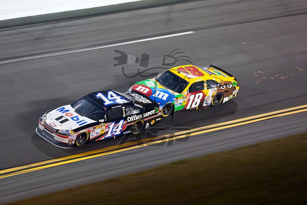 Daytona Beach, FL - Feb 18, 2012:  Tony Stewart (14) and Kyle Busch (18) run nose to tail off turn 4 for the lead during the Budweiser Shootout at the Daytona International Speedway in Daytona Beach, FL.