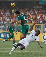 Photo: Steve Bond/Richard Lane Photography.<br /> Ghana v Morocco. Africa Cup of Nations. 28/01/2008. Elamin erbate (L) clears as Asamoah Gyan (R) goes over