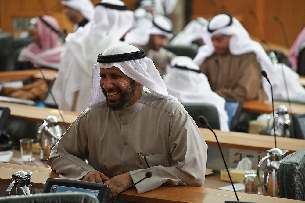 Member of Parliament Abdullatif Al-Omairi smiles on the sidelines of the inaugural session of the new National Assembly Feb. 15, 2012 in Kuwait City. Kuwaitis voted Feb. 2 for a new 50-member National Assembly (parliament).