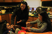 Kearny, New Jersey. November 19, 2013. Yadira Aleman feeds her her niece Areli spoonfuls of soup in her kitchen in Kearny. Photo by Maya Rajamani/NYCity Photo Wire