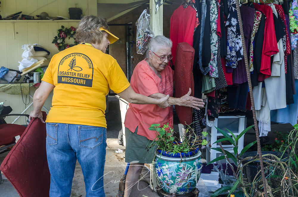 SBDR volunteer Sheila Gatlin, a member of Pisgah Baptist Church in Excelsior Springs, Mo., helps homeowner Fay McDowell find cushions for her dog kennel, Aug. 22, 2016, in Baton Rouge, La. McDowell, who attends Zoar Baptist Church in Baton Rouge, is one of thousands of Louisiana residents whose homes were damaged by floods last week. (Photo by Carmen K. Sisson)