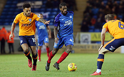 Anthony Grant of Peterborough United in action with Aaron Holloway of Oldham Athletic - Mandatory by-line: Joe Dent/JMP - 20/01/2018 - FOOTBALL - ABAX Stadium - Peterborough, England - Peterborough United v Oldham Athletic - Sky Bet League One
