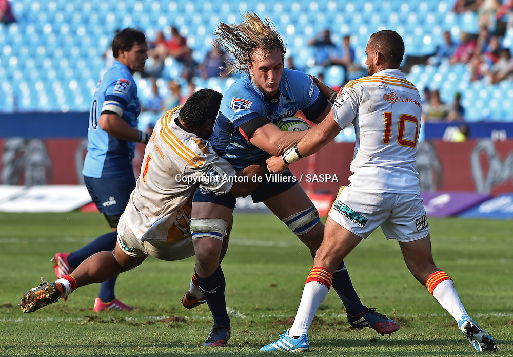 PRETORIA, South Africa, 29 MARCH 2014 : Jacques du Plessis of the Bulls is tackled by Pauliasi Manu and Aaron Cruden (c) of the Chiefs during the Vodacom Super Rugby match between the VODACOM BULLS and the CHIEFS at Loftus Versfeld in Pretoria, South Africa on 29 MARCH 2014. The game ended in a 34 all draw.<br /> <br /> &copy; Anton de Villiers / SASPA