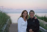 Two sisters enjoy the sunset at Basin Head beach, Prince Edward Island