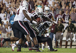 Texas A&M running back Keith Ford (7) rushes over South Carolina defensive back Jamyest Williams (21) at the goal line for a touchdown during the fourth quarter of an NCAA college football game Saturday, Sept. 30, 2017, in College Station, Texas. (AP Photo/Sam Craft)
