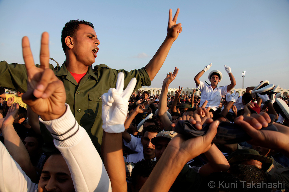 Cadets celebrate during military graduation ceremony in Benghazi, Libya on May 28, 2011. Several hundred cadets are graduated for the first time since the uprise against Col. Muammar Qaddafi began on Feb 17..Photo by Kuni Takahashi.