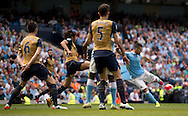 Sergio Aguero of Manchester City scores his team's 1st goal to make it 1-0 during the Barclays Premier League match at the Etihad Stadium, Manchester<br /> Picture by Russell Hart/Focus Images Ltd 07791 688 420<br /> 08/05/2016