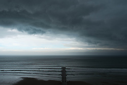 © Licensed to London News Pictures. 07/04/2014<br /> <br /> Saltburn, United Kingdom<br /> <br /> Dark storm clouds form over Saltburn by the Sea in Cleveland.<br /> <br /> Photo credit : Ian Forsyth/LNP