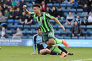 Lyle Taylor forward for AFC Wimbledon (33) puts AFC Wimbledon 0-1 up during the Sky Bet League 2 match between Wycombe Wanderers and AFC Wimbledon at Adams Park, High Wycombe, England on 2 April 2016. Photo by Stuart Butcher.