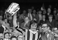975-216<br /> Kilkenny Captain Billy Fitzpatrick holds the McCarthy Cup aloft after beating Galway in the All-Ireland Hurling Final at Croke Park.<br /> (Part of the Independent Newspapers Ireland/NLI collection.)