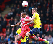 Leyton Orient striker Jay Simpson and Oxford defender Joe Skarz compete for a high ball during the Sky Bet League 2 match between Leyton Orient and Oxford United at the Matchroom Stadium, London, England on 17 October 2015. Photo by Bennett Dean.