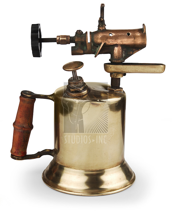 vintage brass blowtorch on white background