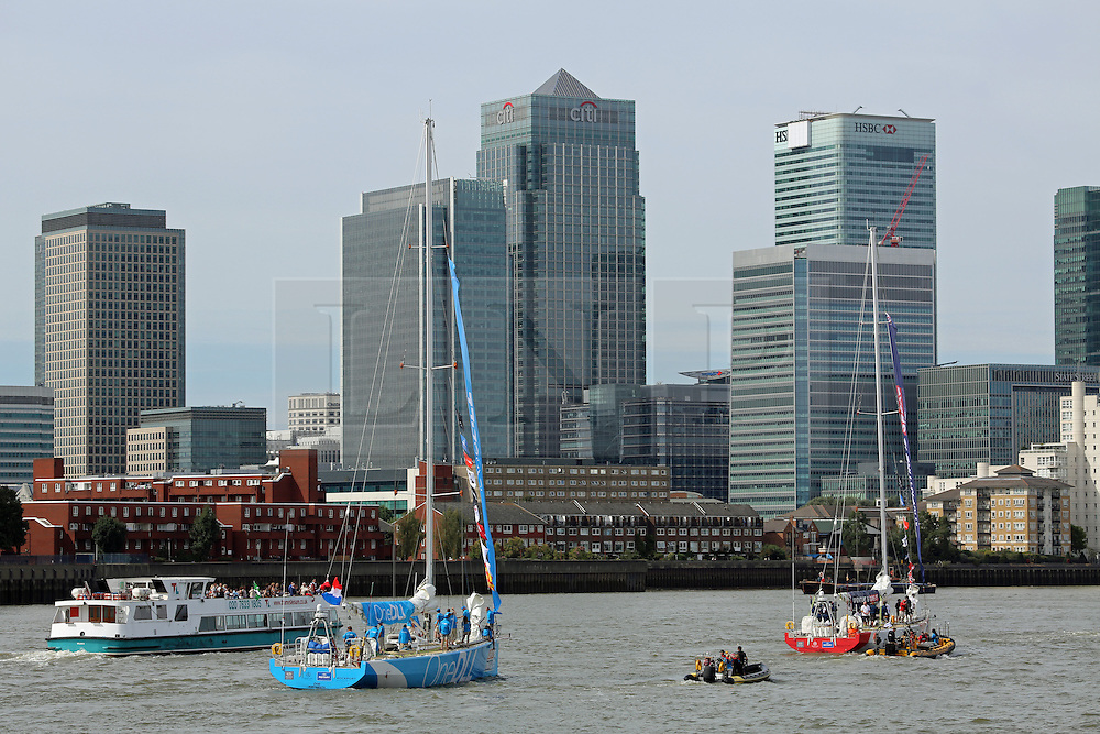 © Licensed to London News Pictures. 01/09/2013.  Photos of vessels taking part in the Clipper Race. The 11-month round the world race started today at Tower Bridge. Seen here passing Canary Wharf. Credit : Rob Powell/LNP