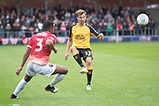 Cambridge United midfielder Harrison Dunk about to be tackled by Salford City defender Ibou Touray during the EFL Sky Bet League 2 match between Salford City and Cambridge United at Moor Lane, Salford, United Kingdom on 12 October 2019.