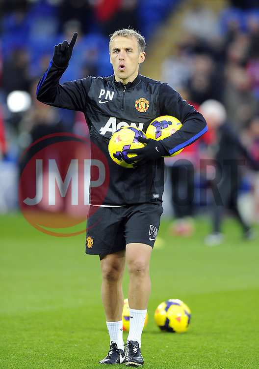 Manchester United Coach Phil Neville  - Photo mandatory by-line: Joseph Meredith/JMP - Tel: Mobile: 07966 386802 - 24/11/2013 - SPORT - FOOTBALL - Cardiff City Stadium - Cardiff City v Manchester United - Barclays Premier League.
