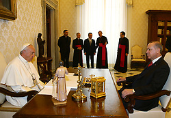 February 5, 2018 - Vatican City, Vatican - February 5, 2018 - Vatican City, Vatican - Turkish President Recep Tayyip Erdogan, right, and Pope Francis sit to talk as they meet at the Vatican, Monday, Feb. 5, 2018. Erdogan is the first Turkish president to visit the Vatican in nearly six decades. Francis met with him during his 2014 trip to Istanbul. (Credit Image: © Turkish Presidency/Depo Photos via ZUMA Wire)