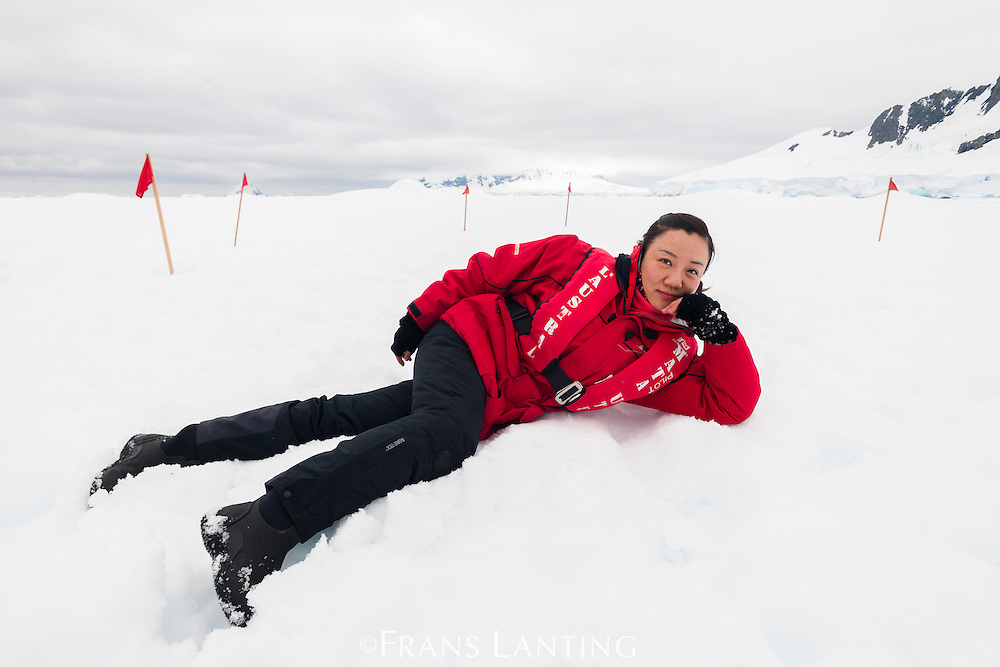 Chen Yayun posing for portrait on snow, Antarctica