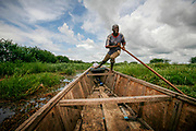 Boatman Ousman pushes his boat through tall grass near Guité in the overgrown Lake Chad. The lake has shrinked to a twentieth of the size it was in 1963, according  to the United Nations Environment Programme. Major overgrazing and unsustainable irrigation projects from all the countries who share border in the area are contributing factors, resulting in loss of vegetation and a drier climate. With a projected temperature increase due to global warming and an advancing Sahara desert, the future does not look good. The picture was taken in 2007, when the boatmen still could access the lake via a connected river. Today the boatmen no longer dare sail for fear of Boko Haram fighters, according to AFP.