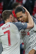 GOAL 1-2 Liverpool midfielder James Milner (7) congratulates Liverpool defender Virgil van Dijk (4) after heading in Liverpool's second of the night during the Champions League match between Bayern Munich and Liverpool at the Allianz Arena, Munich, Germany, on 13 March 2019.