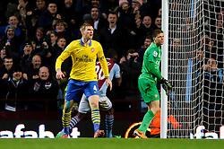 Arsenal Defender Per Mertesacker (GER) reacts angrily and  Goalkeeper Wojciech Szczesny (POL) looks on as a goal goes in from Aston Villa Forward Christian Benteke (BEL) during the second half of the match - Photo mandatory by-line: Rogan Thomson/JMP - Tel: Mobile: 07966 386802 - 13/01/2014 - SPORT - FOOTBALL - Villa Park, Birmingham - Aston Villa v Arsenal  - Barclays Premier League.