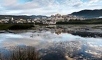 Early morning on the lake in front of Gedan Songzanlin Monastery, also called Guihua Monastery, is the largest Tibetan Buddhist monastery in Yunnan province.