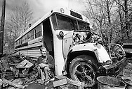 Portrait of Rural Homeless. An elderly couple live in a broken-down school bus in eastern Kentucky.  (Photo by Alan Lessig/Courier Journal)