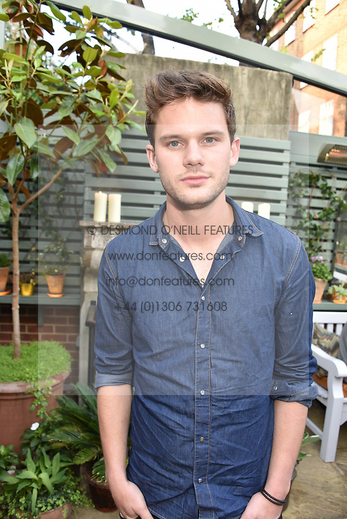 Jeremy Irvine at The Ivy Chelsea Garden's Annual Summer Garden Party, The Ivy Chelsea Garden, 197 King's Road, London England. 9 May 2017.<br /> Photo by Dominic O'Neill/SilverHub 0203 174 1069 sales@silverhubmedia.com