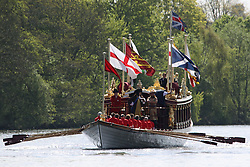 "© Licensed to London News Pictures. 18/04/2014. The Queen's Row Barge Gloriana on the Thames at Hampton Court in Good Friday's glorious sunshine. It was the first engagement of 2014 for the popular row barge and she was rowed to Hampton Court Palace with ""King George I"" on board for the palace's Glorious Georges season .  Credit : Rob Powell/LNP"