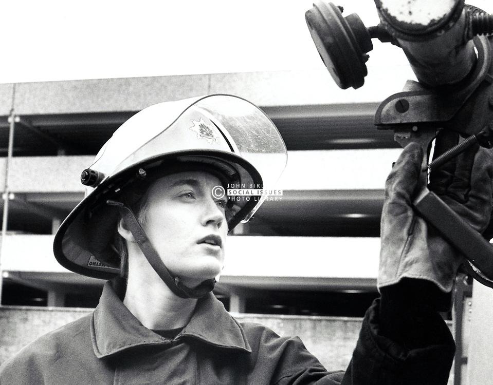 Female fire fighter, Beeston, UK 1980s
