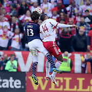 Jermaine Jones, (left), New England Revolution, and Thierry Henry, New York Red Bulls, challenge for a header during the New York Red Bulls Vs New England Revolution, MLS Eastern Conference Final, first leg at Red Bull Arena, Harrison, New Jersey. USA. 23rd November 2014. Photo Tim Clayton