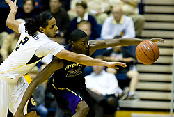 February 11, 2010; Berkeley, CA, USA;  Washington Huskies forward Justin Holiday (22) grabs a loose ball from California Golden Bears guard Jorge Gutierrez (2) during the first half at the Haas Pavilion.  California defeated Washington 93-81.