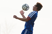 Mt. Anthony's Isaac Salem (18) leaps to head the ball during the boys semifinal soccer game between Mount Anthony and Champlain Valley Union at CVU high school on Tuesday afternoon October 27, 2015 in Hinesburg. (BRIAN JENKINS/ for the FREE PRESS)