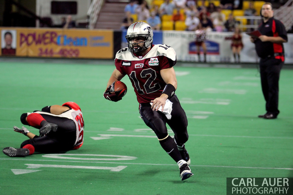 6-28-2007: Anchorage, AK - Wild quarterback David Short scrambles for a touchdown in the Alaska Wild 47 to 53 loss to the CenTex Barracudas at the Sullivan Arena...