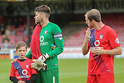 York City goalkeeper Scott Flinders with York City mascot during the Sky Bet League 2 match between York City and AFC Wimbledon at Bootham Crescent, York, England on 24 October 2015. Photo by Simon Davies.