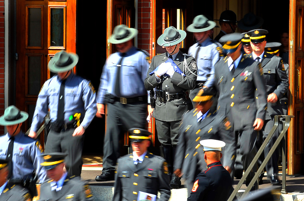 A State Trooper stands in the center of the exit of St. Peter's Cathedral as police exit the church after the funeral of CPL. Bryon Dickson.