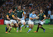 Argentina's Santiago Cordero bursting through a crowd of South African players during the Rugby World Cup Bronze Final match between South Africa and Argentina at the Queen Elizabeth II Olympic Park, London, United Kingdom on 30 October 2015. Photo by Matthew Redman.