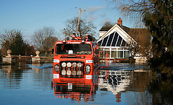 © London News Pictures. 24/02/2014. Moorland, UK. Members of a  fire rescue team drive through waist deep flood water in Moorland on the Somerset Levels, which continues to suffer from sever flooding. Photo credit: Jason Bryant/LNP