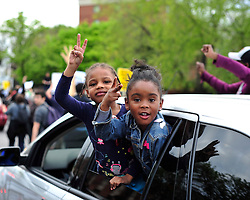 Young girls hang out the window of a car that was stuck in the traffic jam of a large protest in reaction to the announcement of homicide charges towards police officers in connection with the April 12th death of Freddie Gray on May 1, 2015, in Baltimore, Md.