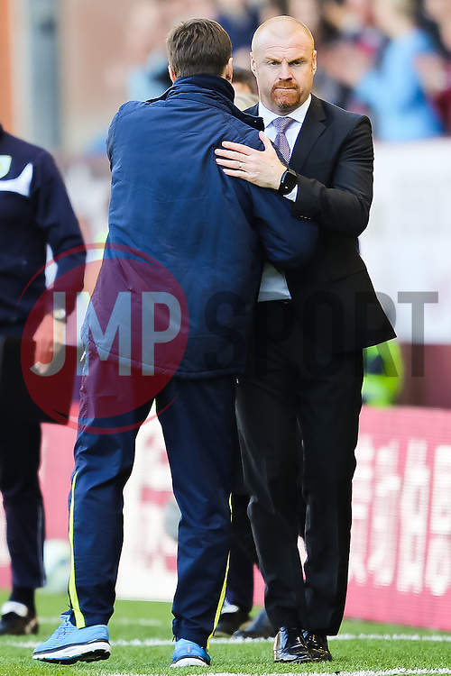 Burnley Manager, Sean Dyche shakes hands with Tottenham Hotspur Manager Mauricio Pochettino after the final whistle  - Photo mandatory by-line: Matt McNulty/JMP - Mobile: 07966 386802 - 05/04/2015 - SPORT - Football - Burnley - Turf Moor - Burnley v Tottenham Hotspur - Barclays Premier League