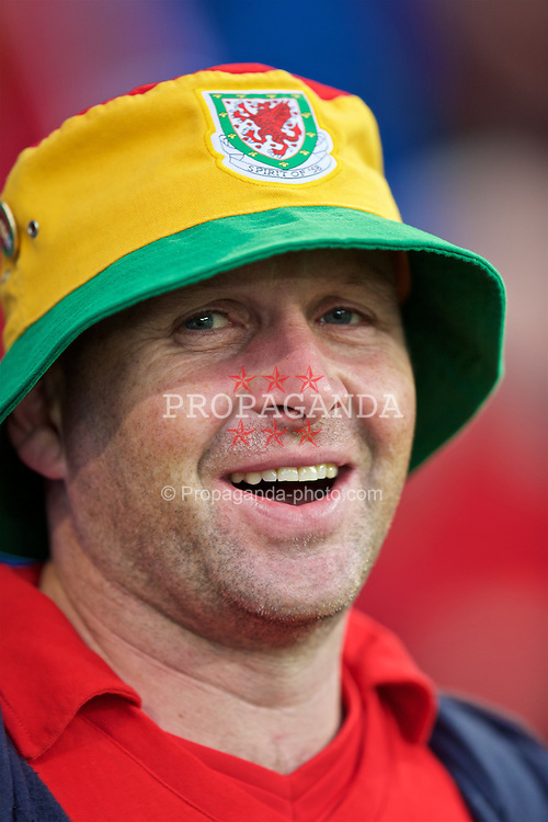 CARDIFF, WALES - Monday, September 5, 2016: A Wales supporter wearing a Spirit of 58 bucket hat before the 2018 FIFA World Cup Qualifying Group D match against Moldova at the Cardiff City Stadium. (Pic by David Rawcliffe/Propaganda)