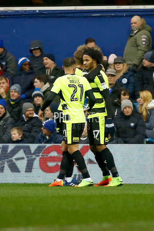 Huddersfield Town players celebrate a goal from Huddersfield Town striker Isaiah Brown (37) (score 0-1) during the EFL Sky Bet Championship match between Queens Park Rangers and Huddersfield Town at the Loftus Road Stadium, London, England on 11 February 2017. Photo by Andy Walter.