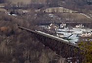 Salisbury Mills, New York - A Metro North train crosses the Moodna Viaducts railroad trestle in a view from Schunnemunk Mountain on Dec. 16, 2010.
