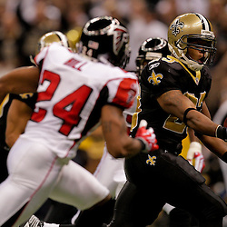 2009 November 02:  New Orleans Saints running back Pierre Thomas (23) scores a touchdown past Atlanta Falcons cornerback Tye Hill (24) in the first half against the Atlanta Falcons during a 35-27 win by the Saints over the Falcons at the Louisiana Superdome in New Orleans, Louisiana.