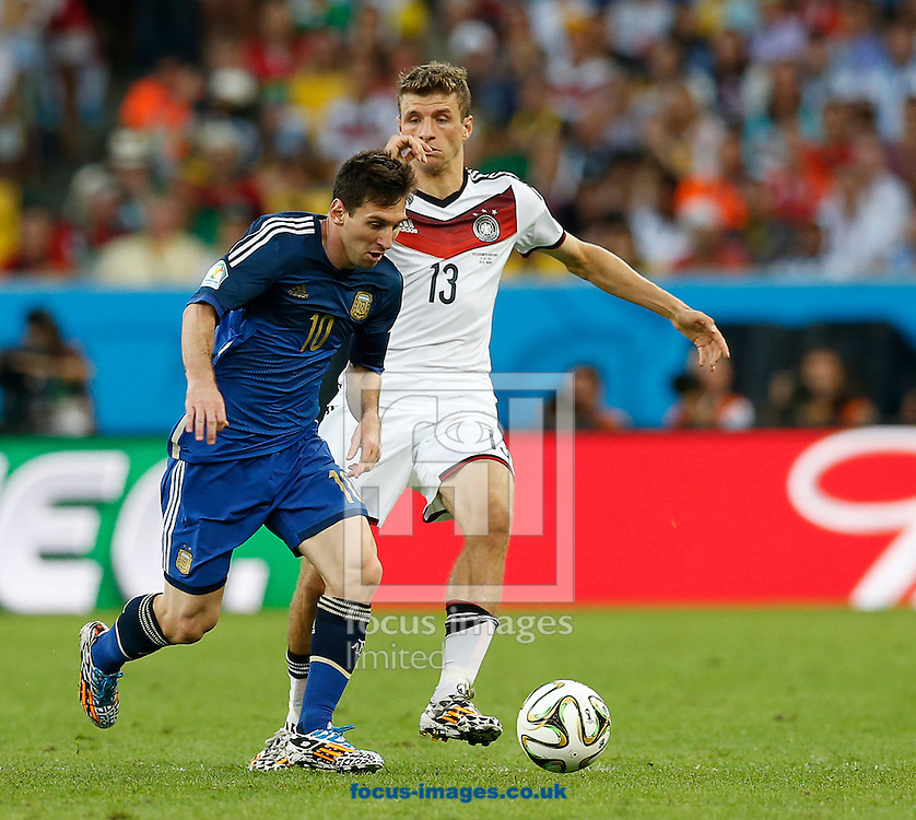Argentina's Lionel Messi gets away from Germany's Thomas Muller during the 2014 FIFA World Cup Final match at Maracana Stadium, Rio de Janeiro<br /> Picture by Andrew Tobin/Focus Images Ltd +44 7710 761829<br /> 13/07/2014