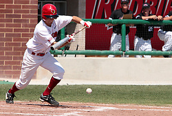 18 April 2010: Brett Kay bunts the ball into play.  Southern Illinois Salukis and the Illinois State Redbirds face off on Duffy Bass Field on the campus of Illinois State University in Normal Illinois.